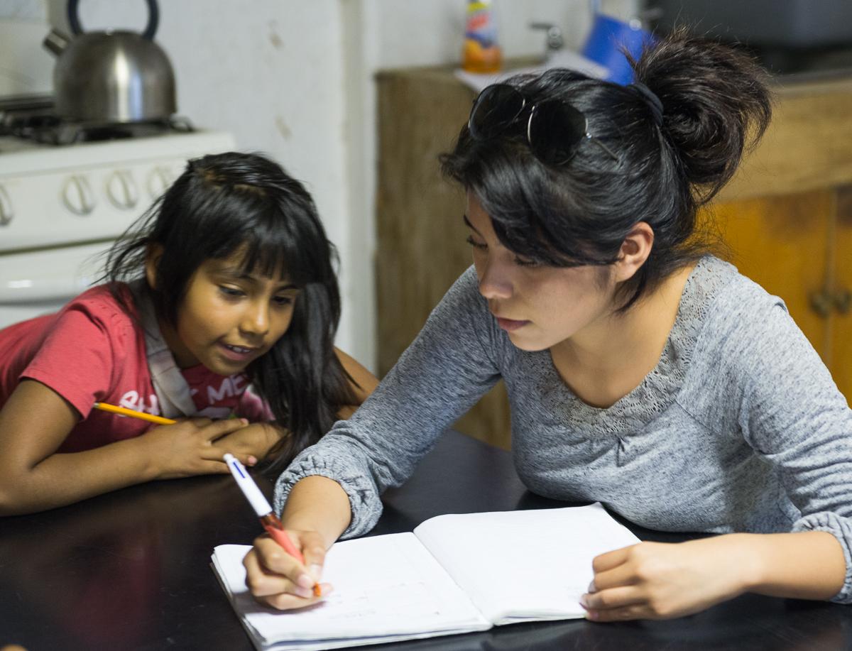 Older student tutoring younger child