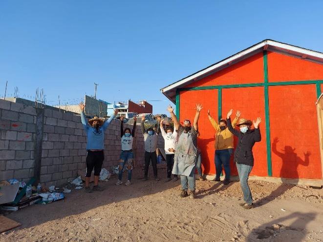 volunteers cheering at a housebuild