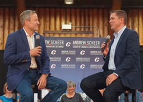 Byron & Andrew Scheer talking on stage