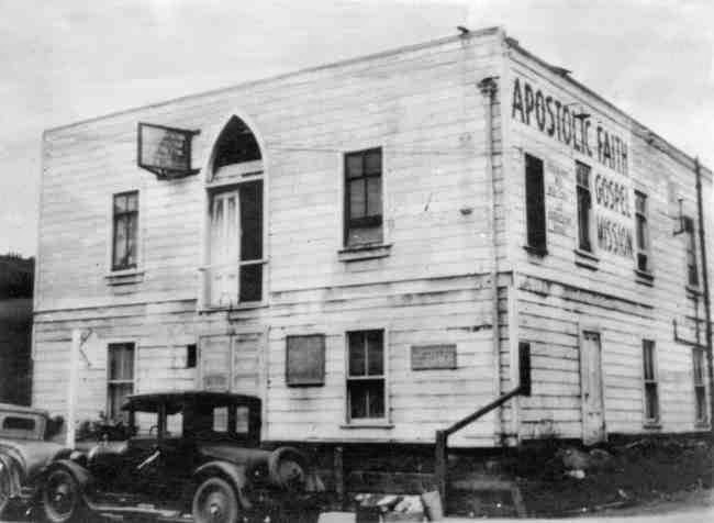 A black and white image of the Apostolic Faith Mission church building.