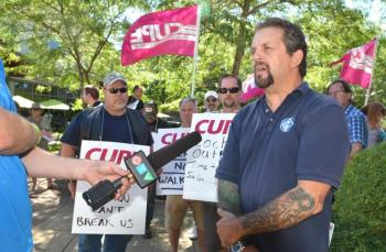 CUPE 401 Acting President Laurence Amy addresses the rally