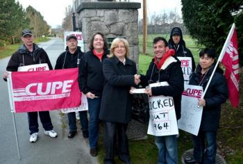 CUPE 3966 president Barbara Wilson and locked out 4964 vice-president Mike Pavlicevic at the gates to the Quilchena Golf Course