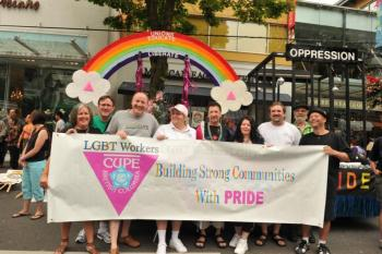 LIBERATION NOW!—Strutting their stuff at the annual Pride Parade on August 1 were, from left: CUPE 389 member Carol Nordby, CUPE Communications rep Dan Gawthrop, CUPE BC general vice president Paul Faoro, Pink Triangle working group members Kathy McMahon and Kevin Robichaud, Pink Triangle chair and general vice president Cindy McQueen, secretary-treasurer Mark Hancock, CUPE 1936 president Michael Lanier, and National Pink Triangle committee member Peter DeGroot.