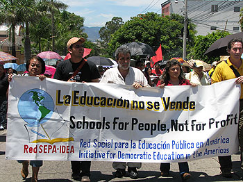 EDUCATOR HIT LIST—CoDevelopment Canada program director Steve Stewart (right), attending one of many rallies held in the Honduran capital of Tegucigalpa and around the country since the June 28 coup. Teachers and other unionized education workers, among t