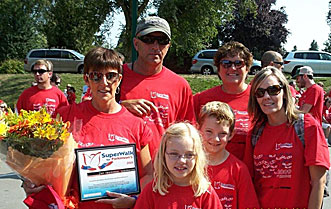 RECORD BREAKERS—Maria Wahl poses with partner Garvin, granddaughter Alyssa, grandson Austin, sister-in-law Bev and daughter Kristen after raising $18,160 for the fight against Parkinson's disease.