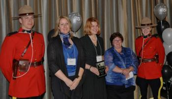 """Marya Moffat (second from right) was proud to present Krista Levar (middle, holding plaque) with the Program Staff Leadership Award of Excellence for Police Victim Services of British Columbia conference. Moffat says, """"Krista has gone above and beyond the call of duty on many occasions, and always lends a helping hand to others in need. She is always ready to listen, and has the ability to turn most negatives into a positive."""" Also pictured are two RCMP officers and Heather Hildred, victim services program director of B.C."""