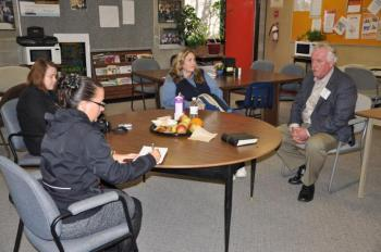 Barry O'Neill meets with members of the Comox media and a school trustee.