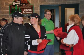 CUPE 118 members Crystal Dorin and Ryan Foster hand out airplane toss entries for the first intermission activity.