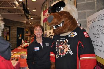 Janine Langford and Bernie, the Bulldogs' mascot, join forces at CUPE 118's booth during the first play-off game of the Alberni Valley Bulldogs.