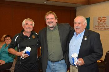 YEARS OF SERVICE—CUPE BC President Mark Hancock presented retirement gifts to Rocco Mastrobuono (left) and Gerry Shmon.