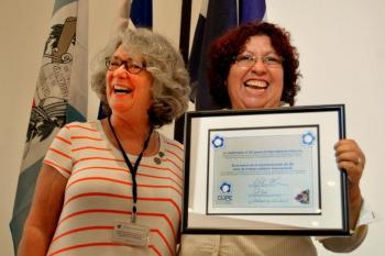 CUPE BC general V-P Susan Blair presents CUPE Certificate to MEC executive director Sandra Ramos at mass meeting in Managua, Nicaragua.