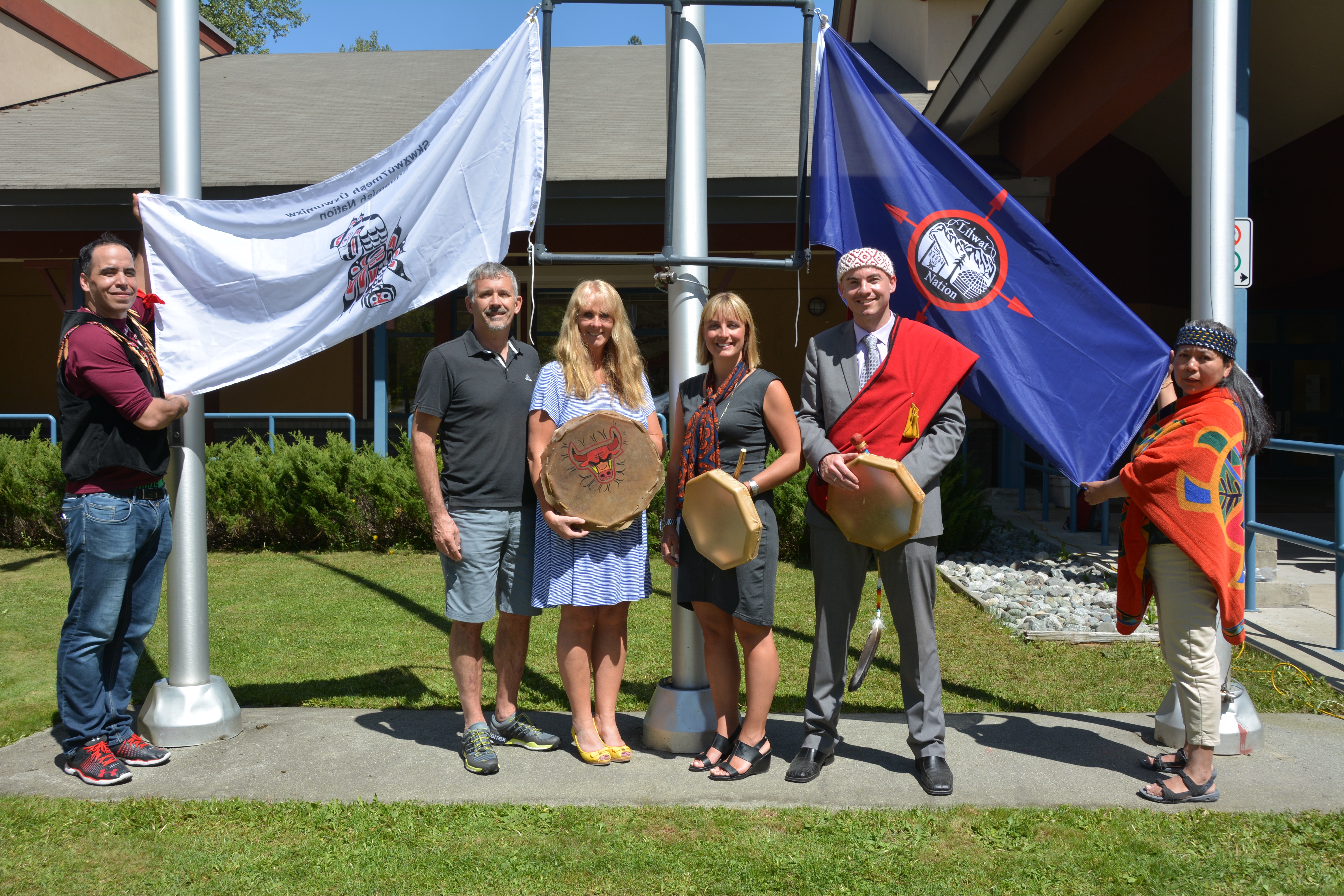 WORKING TOGETHER—Members of CUPE Local 779 (School District 48 support staff), flanked by members of the Squamish (left) and Lil'wat First Nations, helped organize the May 6 flag-raising event.