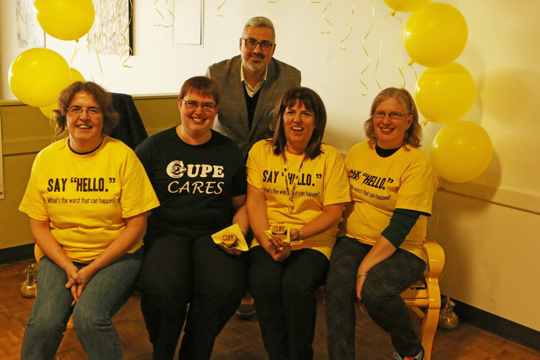 CUPE 1858 members raised funds for a friendship bench at VIU as a legacy project. Pictured (L–R) are CUPE 1858 executive members Bernie Heise, CUPE 1858 President Deborah Hopper, Shannon McKenzie and Annette Woolf, with Sam Fiorella, a co-founder of the project.