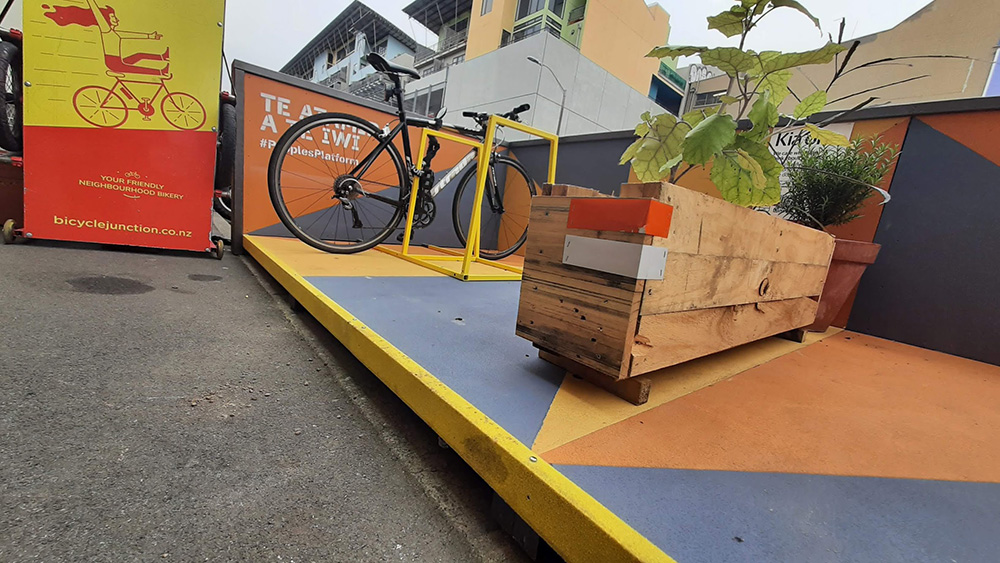 Bicycle Junction parklet with bicycle parking and planter.