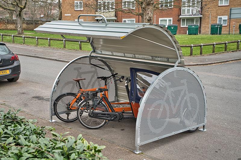 Secure Cyclehoop on street bike hanger with bikes inside.