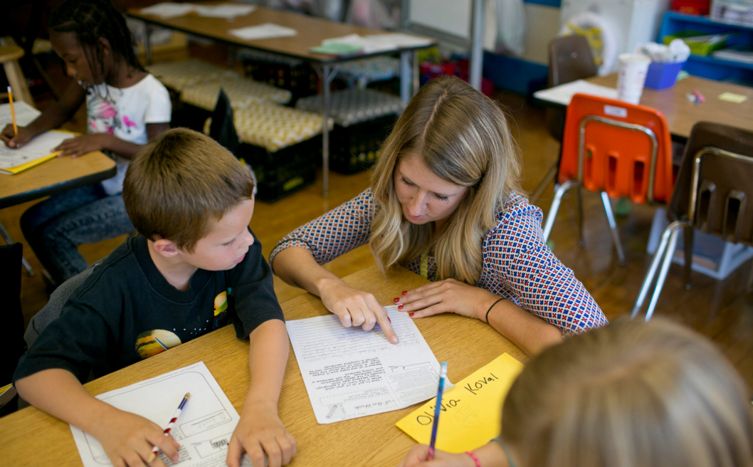 Allison Pitt, a third-grade teacher in Columbus, Ohio, helped Charles Swank last month at West Broad Elementary School. Photo by Andrew Spear for the New York Times.