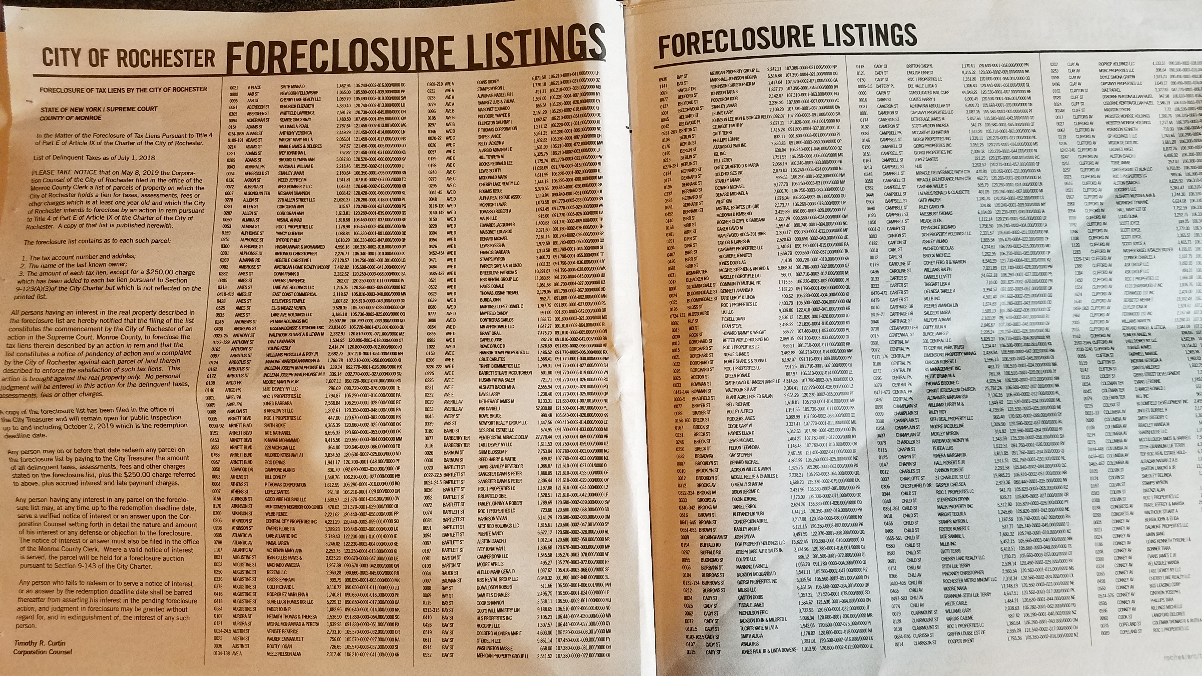 A picture of a list of City of Rochester foreclosures published in City Newspaper
