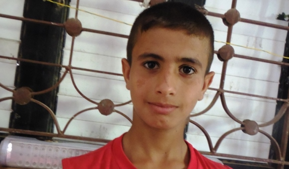 Haitham, 12, has struggled to keep up at school since losing his younger siblings Aya and Munther.