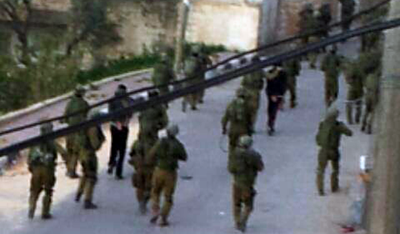 Israel forces detain several Palestinian youth from the occupied West Bank village of Haris early on March 15, 2013.