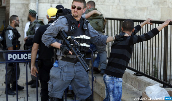 Israeli forces stop and search a Palestinian boy at the entrance of Damascus Gate, outside Jerusalem's Old City, on February 19, 2016. (Photo: AFP / Ahmad Gharabli)