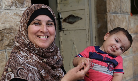 Ammar's mother and younger brother, who was born while Ammar was serving his sentence in Megiddo prison. (Photo: DCIP)