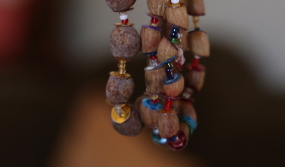 A necklace of olive pits and beads, made by a child prisoner of Megiddo prison. (Photo: DCIP)
