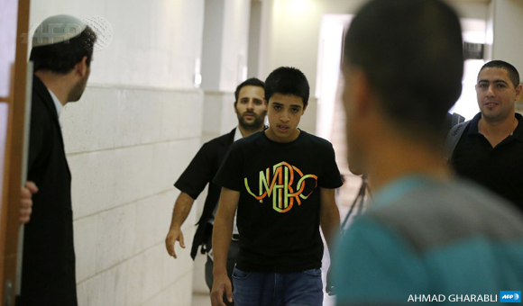 Ahmad Manasra, 14, convicted of attempted murder of two Israelis in a stabbing in October, walks out of the Jerusalem District Court following a sentencing hearing on July 11, 2016.