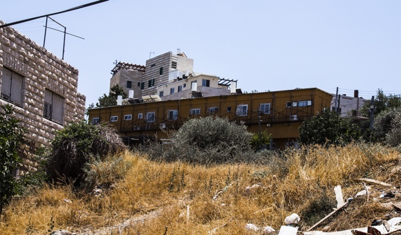 The orange caravans pictured are part of the Tel Rumeida settlement illegally established in 1984 inside of the Palestinian Tel Rumeida neighborhood in Hebron. (Photo: DCIP / Cody O'Rourke)