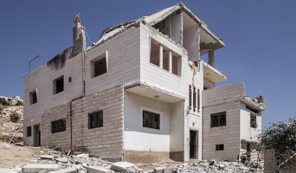 All three floors of Ahmad Makhamra's apartment building sustained damage from the Israeli forces' use of explosives during the demolition. (Photo: DCIP / Cody O'Rourke)