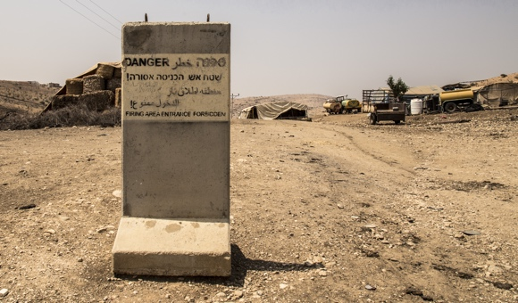 A concrete marker placed by Israeli forces demarcating the beginning of the military zone near Tubas in the Jordan Valley, northern West Bank. (Photo: DCIP / Cody O'Rourke)