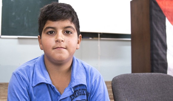 """Mohammad D., 13. """"My teacher hit me because I did not do my homework. I tell them to stop the violence in order for kids to love education."""" (Photo: DCIP / Cody O'Rourke)"""