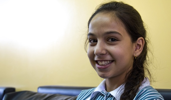 """Aya K., 12. """"I remember one of my teachers hit us because we were loud and messy. We should not use violence. It is something bad."""" (Photo: DCIP / Cody O'Rourke)"""