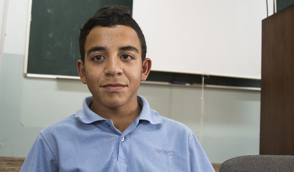 "Qusai H., 14. ""I feel bad because of the Wall surrounding the school. Teachers hit me and there are Israeli soldiers on the street outside the school."" (Photo: DCIP / Cody O'Rourke)"
