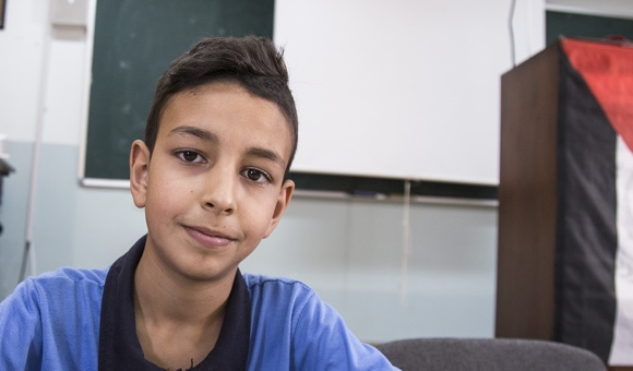 "Tamer A., 13. ""[Children's rights mean] taking care of yourself and talking to others."" (Photo: DCIP / Cody O'Rourke)"