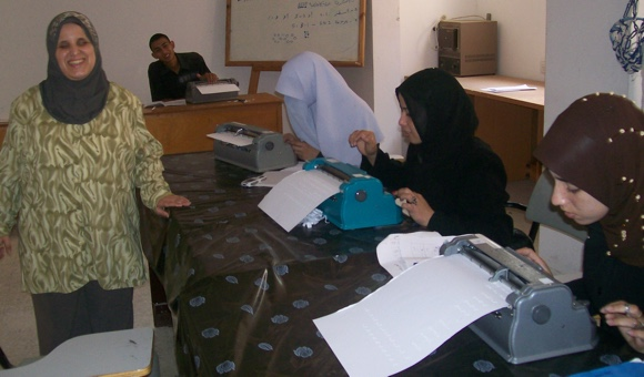 Dalal al-Taji teaching students 'Braille' at the University Collegeof Ability Development, as part of a PRCS bachelor's program in Special Ed and Rehabilitation, Khan Younis, Gaza. (Photo: Jean Calder).
