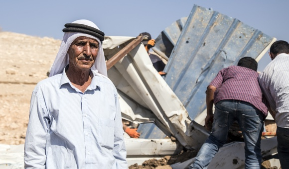 Mahmoud Ayyoub stands where he and his family of 15 lived before Israeli forces demolished their homes in Ein Al-Beida, near Tubas, in the Jordan Valley. (Photo: DCIP / Cody O'Rourke)