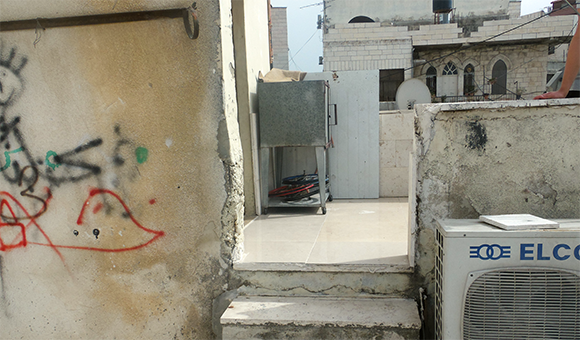 Photo of exact location Nour al-Din Mustafa was standing at the time he was shot in the face. (Photo: DCIP)