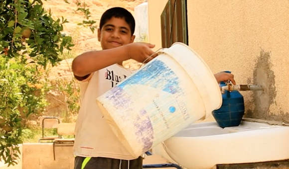 Children in Al-Jiftlik can't remember when they had enough water