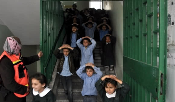An evacuation practice takes place at Beit Dajan elementary school in Gaza City's Shuja'iyya neighborhood. (Source: courtesy of the Ministry of Education)