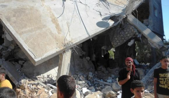 Five families resided in the building leveled by an Israeli airstrike in the southern Gaza city of Khan Younis on Tuesday.