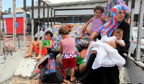 A family arrives at an UNRWA School in Gaza City after fleeing their home in Beit Lahia. (DCIP/Eloise Bollack)