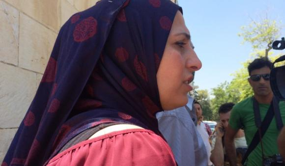 Tariq Abu Khdeir's mother, Suha, addresses journalists outside the courthouse in Jerusalem's Russian Compound.