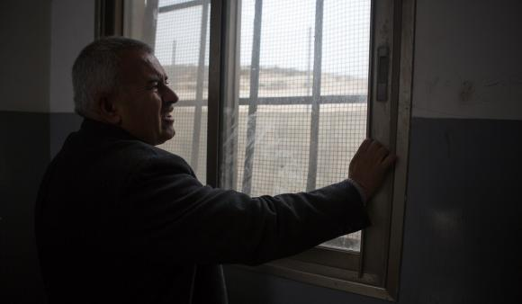 Principal Nabil al-Najjar of Urif School says window bars protect from stones thrown by settlers. (DCIP / Dylan Collins)