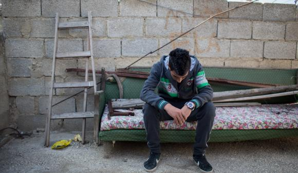 Yazan Z, 16, was shot in the leg at close range outside his high school in Jalazoun refugee camp. (DCIP / Dylan Collins)