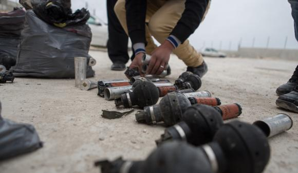 Ninth graders at Urif school, Nablus lay out tear gas canisters fired into school grounds. (DCIP / Dylan Collins)