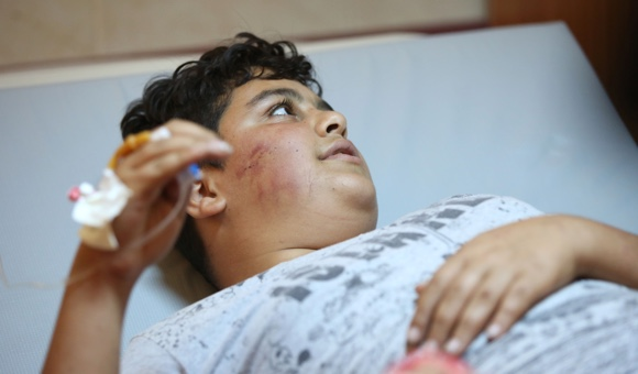 Israeli settlers beat, drag Palestinian boy in northern West Bank