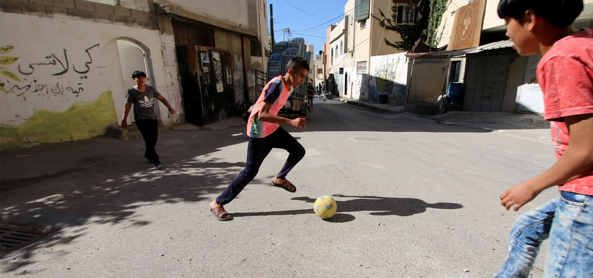 Palestinian children play soccer in the streets of Jenin refugee camp in the northern West Bank on May 11, 2017. (Photo: DCIP / Ahmad al-Bazz)