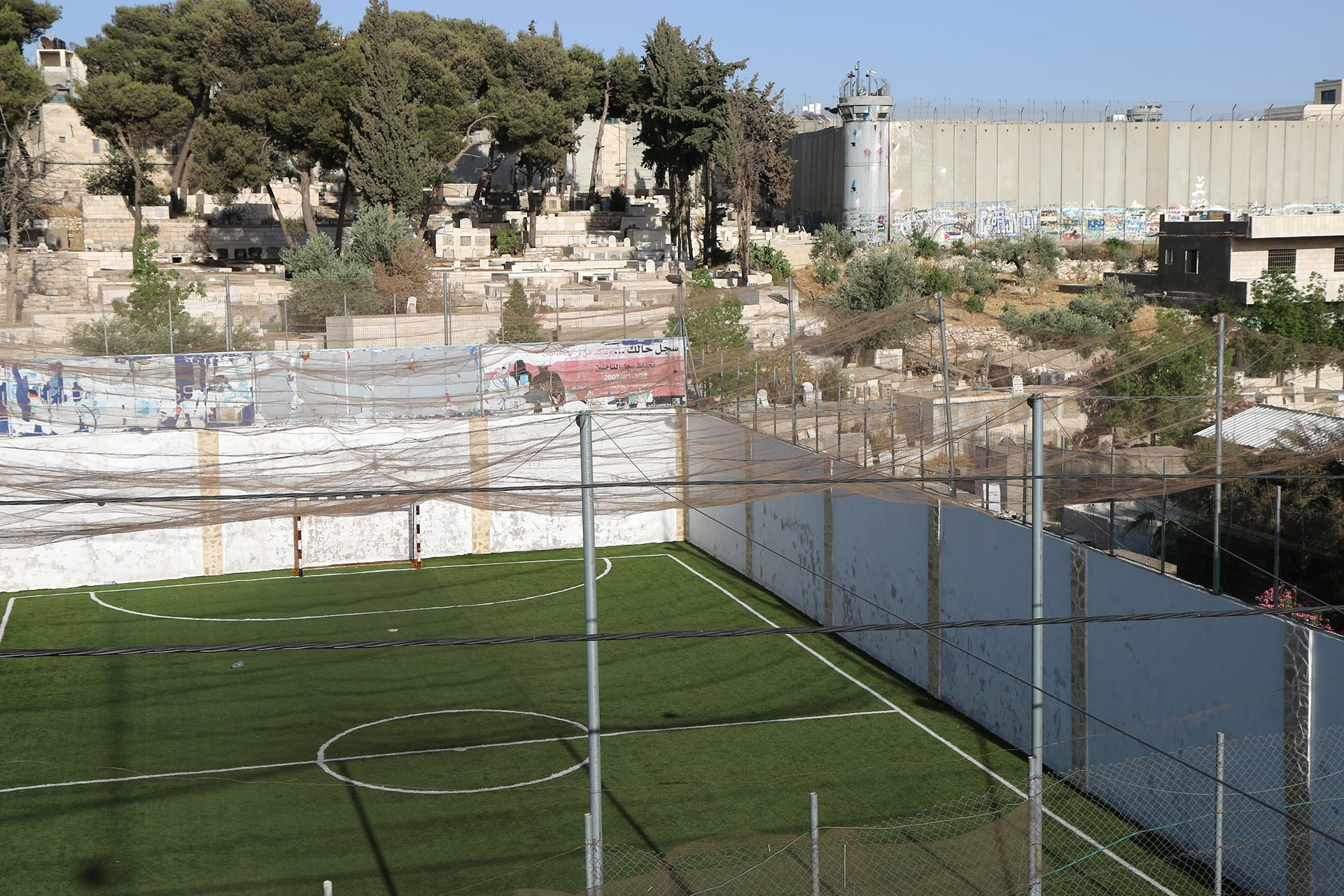 Lajee Center's soccer field and recreation area directly adjacent to the concrete barrier and Israeli military base next to Rachel's Tomb. (Photo: DCIP / Ahmad Al-Bazz)