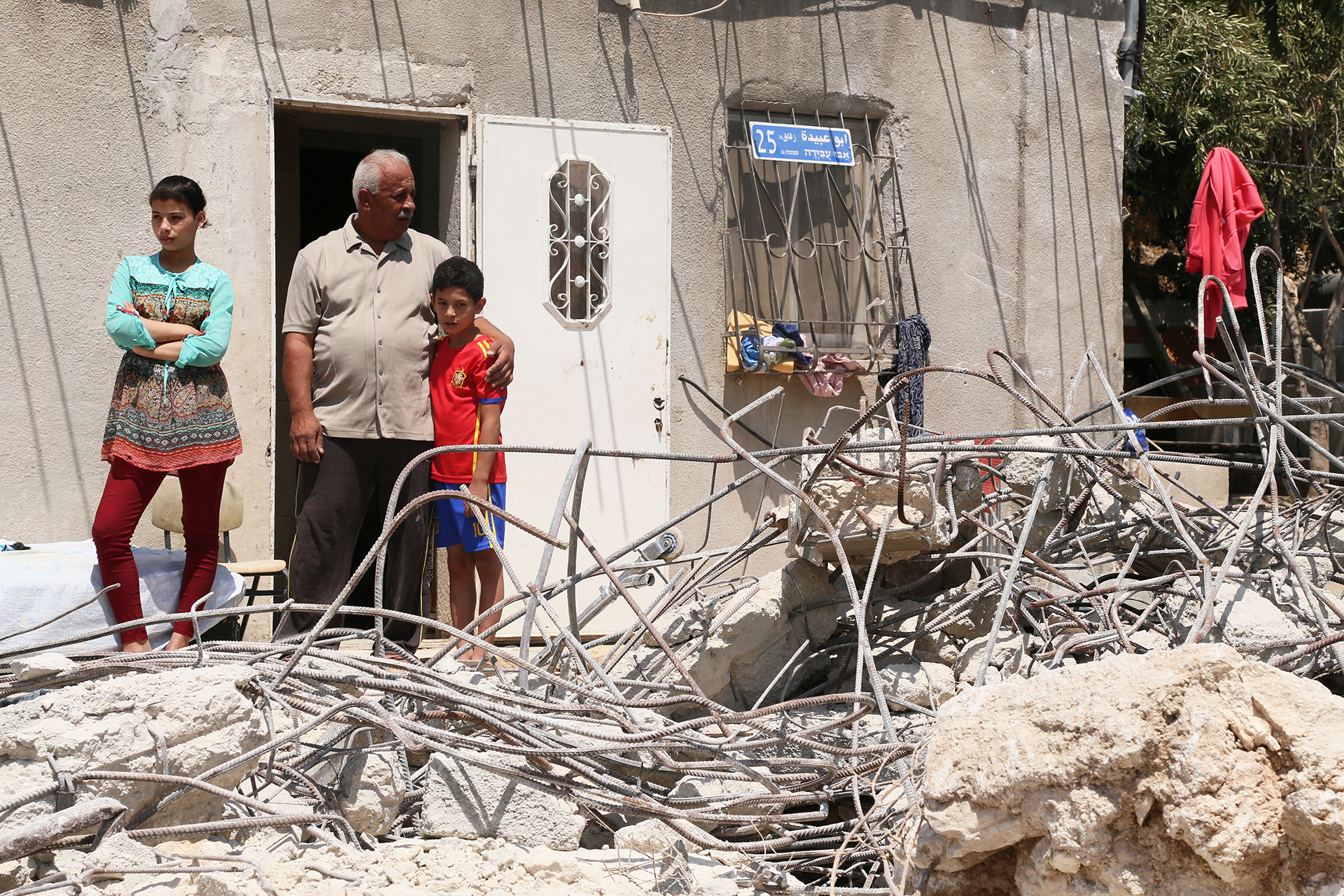 The children's father, Mahmoud Fawaka, demolished the home addition himself, to avoid incurring the much higher cost of a demolition carried out by Israeli authorities. (Photo: DCIP / Ivan Karakashian)