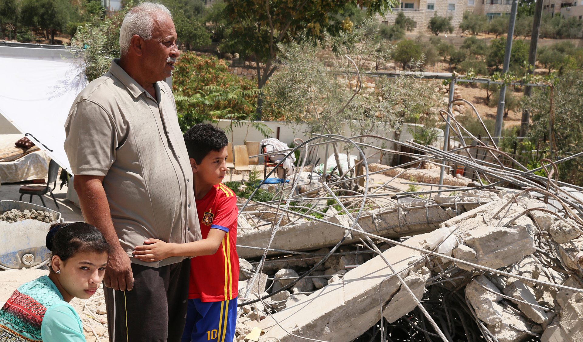 Israeli building laws push father to demolish his children's rooms